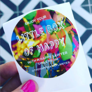 "This is an image of a sticker that says ""enjoy your little box of happy!"""